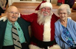 Santa (aka Jack Lardie) with Ed Brown and Mary Johnson at Old Mission Peninsula United Methodist Church, 2015 | Jane Boursaw Photo