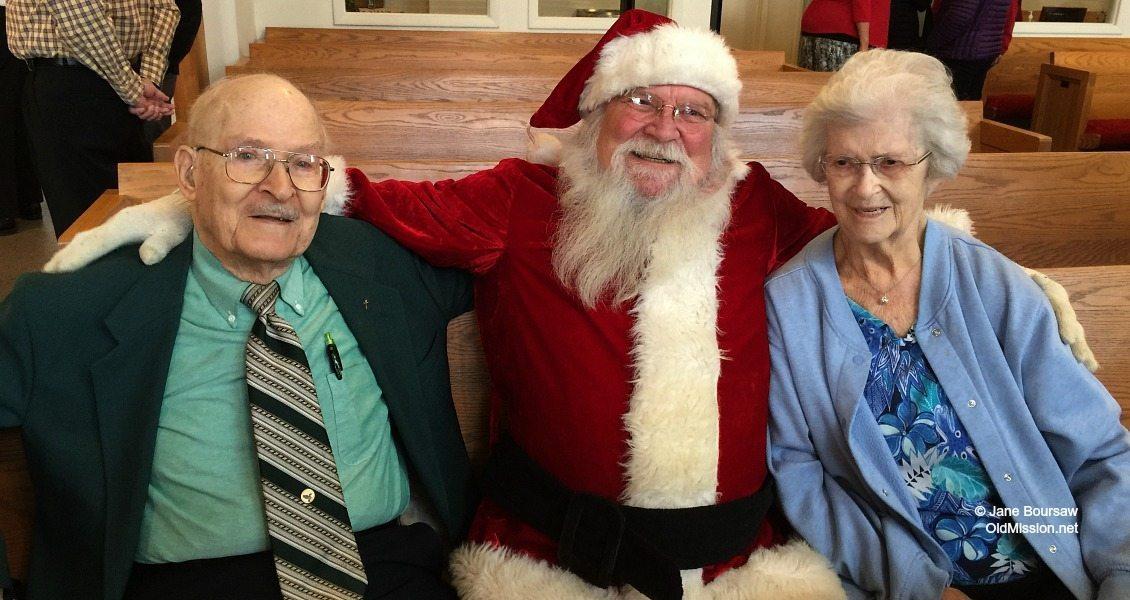 Santa (aka Jack Lardie) with Ed Brown and Mary Johnson at Old Mission Peninsula United Methodist Church, 2015 | Jane Boursaw Photo