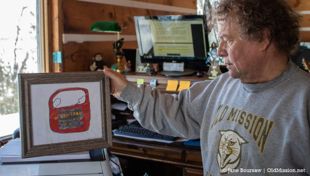 Tim Boursaw with Belle's artwork of Chum Reay's truck door, Old Mission Peninsula