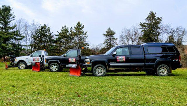 Matt Reay's Snowplowing Trucks with Chum Reay Sign; Portland, Michigan