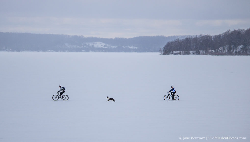 Bikers on West Bay Ice near Power Island on the Old Mission Peninsula