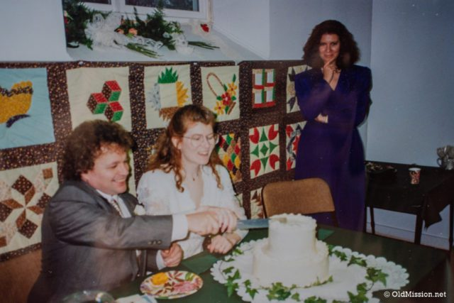 Tim and Jane cut the cake while Carol looks on with glee. New Year's Eve, 1993, Old Mission Congregational Church | Mary Johnson Photo