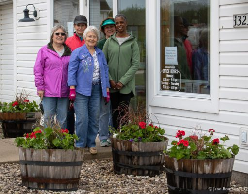 Ladies from the Old Mission Women's Club assemble flower containers at Peninsula Township offices | Jane Boursaw Photo