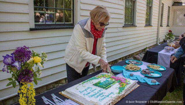 June 15, 2019: Ellen Kerr cuts the cake at the Dougherty House Dedication | Jane Boursaw Photo