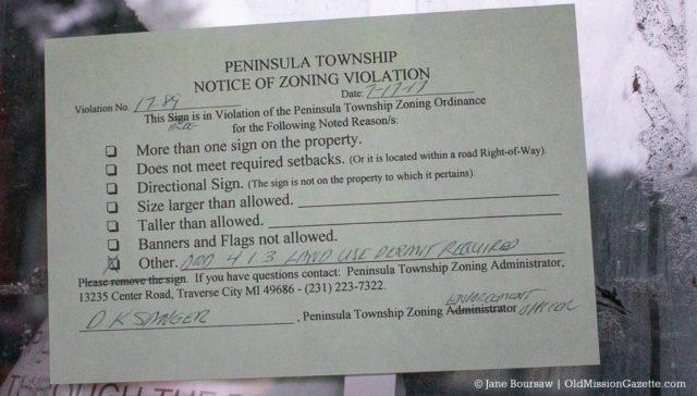 Notice regarding a land use permit violation in Peninsula Township