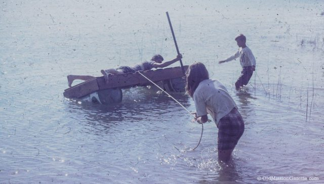Dean, Ward and Carol Johnson on a home-made raft in Old Mission, 1966