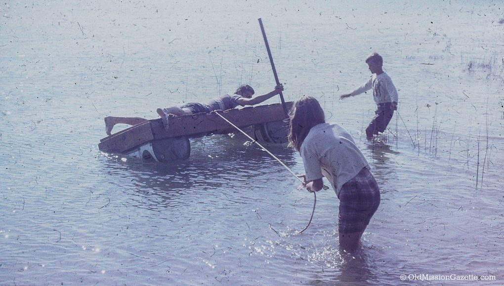 Dean, Ward and Carol Johnson on a home-made raft in Old Mission, 1966 | Mary Johnson Photo