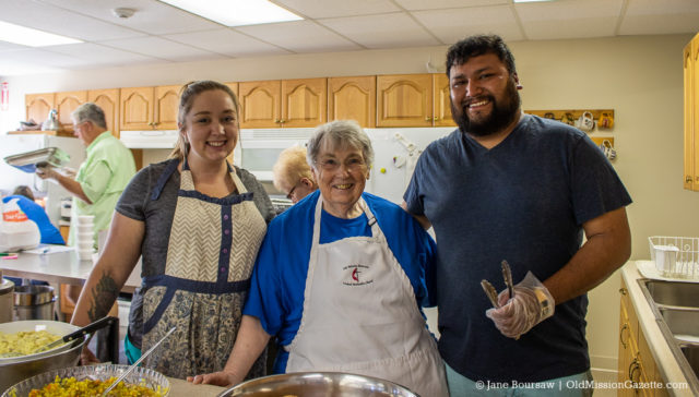 OMPeople: Emma Charlotte, Nancy Heller and Raul Gomez at the OMPUMC Chicken BBQ 2019 (with Kathy Gore photobombing in the background) | Jane Boursaw Photo