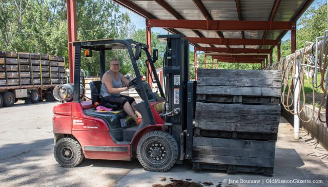 Heatherlyn Johnson on a forklift at Johnson Farms' Cooling Pad on the Old Mission Peninsula