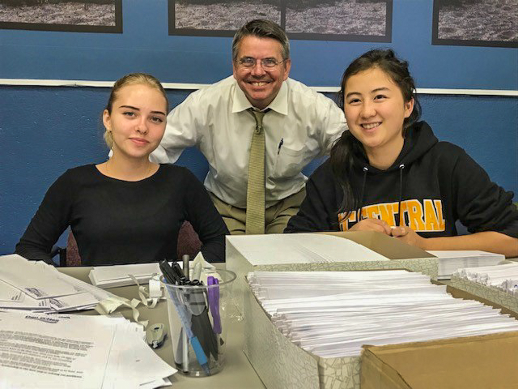 Exchange students Valeria Stepanishcheva (from the Ukraine; stayed with an OMP host family) and Samara Melisbek (Kyrghzstan), volunteering with State Rep. Dan O'Neil (middle) | Olave Russell Photo