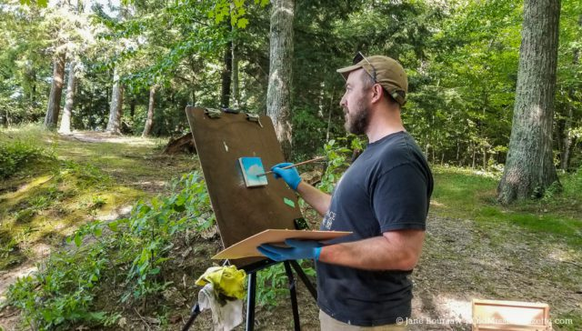 Conor Fagan paints at Lighthouse Park on the Old Mission Peninsula