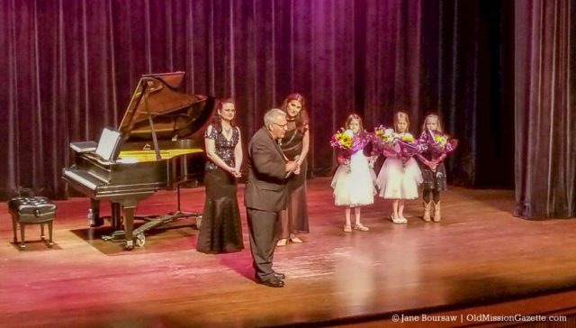 Old Mission Peninsula's Mario Tabone introduces flower girls Mia and Kate Oosterhouse and friend at the Traverse City Wine and Opera Festival presentation of the Bellini Opera at the City Opera House in Traverse City | Jane Boursaw Photo