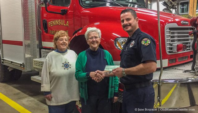 Friendly Garden Club members Terry Harding and Marellene Morrell present a landscaping grant to PFD staffer Nick Haines | Friendly Garden Club Photo