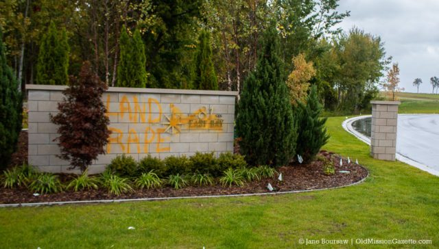 "Vandalism on entrance sign of ""The 81 on East Bay"" development in October 