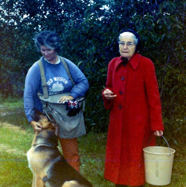 Mary Johnson, Stella Johnson and Duke in Johnson Farms Apple Orchard, The 40, on Old Mission Peninsula, 1970s