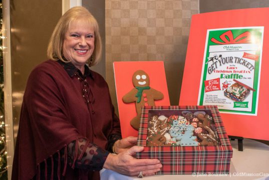 Janis Haine with a box of cookies for the Old Mission Women's Club cookie sale on the Old Mission Peninsula