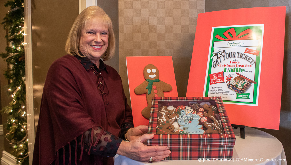 Janis Haine with a box of cookies for the Old Mission Women's Club cookie sale on the Old Mission Peninsula, December 2019
