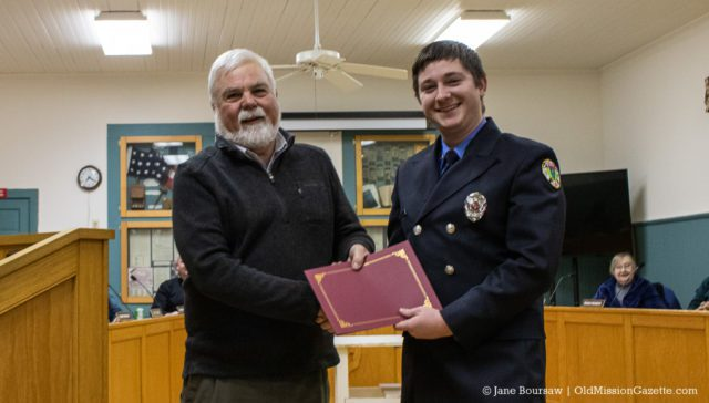 Alex Werly receives an award for his service with the Peninsula Fire Department, along with a handshake from Peninsula Township Supervisor Rob Manigold | Jane Boursaw Photo