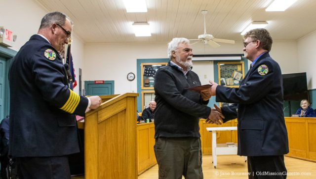 Cory Reamer receives an award for his service with the Peninsula Fire Department, along with a handshake from Peninsula Township Supervisor Rob Manigold | Jane Boursaw Photo