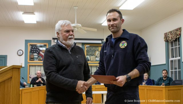 Peninsula Fire Department member Dale Hall receives a Life-Saving Award for his actions during an industrial accident on Bluff Road on July 16, 2019; also pictured, Peninsula Township Supervisor Rob Manigold | Jane Boursaw Photo