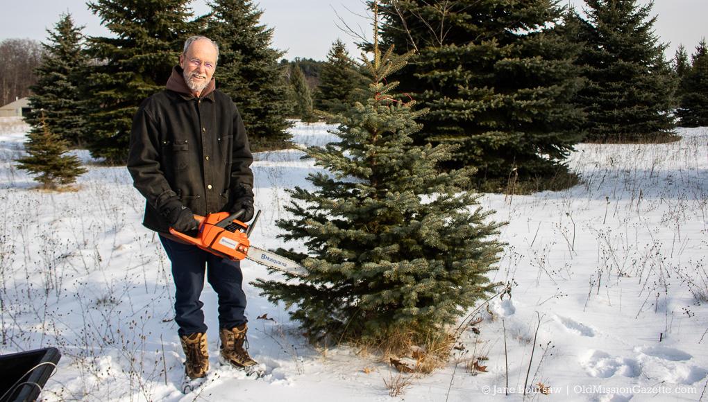 Don Switzer cutting a Christmas Tree on the Old Mission Peninsula | Jane Boursaw Photo
