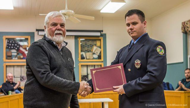 Ethan Passalacqua receives an award for his service with the Peninsula Fire Department, along with a handshake from Peninsula Township Supervisor Rob Manigold | Jason Gillman Photo