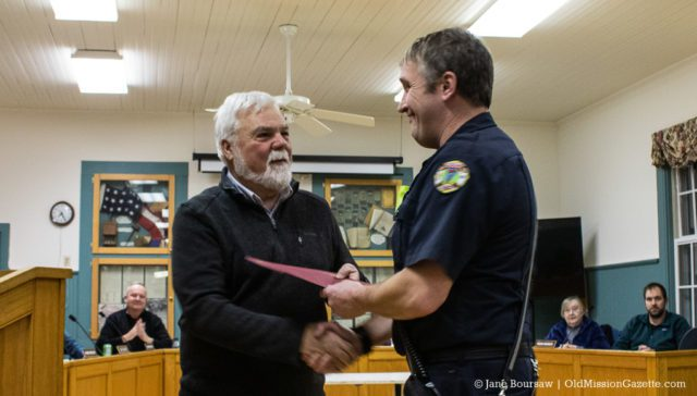 Peninsula Fire Department member Grant Blackmer receives a Life-Saving Award for his actions during an industrial accident on Bluff Road on July 16, 2019; also pictured, Peninsula Township Supervisor Rob Manigold | Jane Boursaw Photo