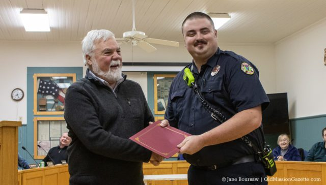 Peninsula Fire Department member Jason Schuitema receives a Life-Saving Award for his actions during an industrial accident on Bluff Road on July 16, 2019; also pictured, Peninsula Township Supervisor Rob Manigold | Jane Boursaw Photo
