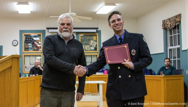 Joseph Sicoli receives an award for his service with the Peninsula Fire Department, along with a handshake from Peninsula Township Supervisor Rob Manigold | Jane Boursaw Photo