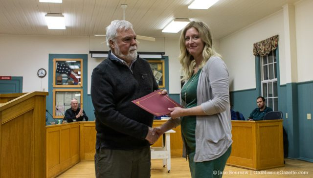 Julie Moore receives a Good Samaritan Award from the Peninsula Fire Department for her life-saving actions during an industrial accident on Bluff Road on July 16, 2019; also pictured, Peninsula Township Supervisor Rob Manigold | Jane Boursaw Photo