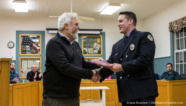 EMT and Firefighter Kyle Sarber receives the Firefighter of the Year Award for his service to the Peninsula Fire Department; also pictured, Peninsula Township Supervisor Rob Manigold | Jane Boursaw Photo