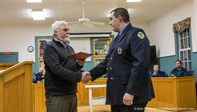 Mike VanderMey receives an award for his service with the Peninsula Fire Department, along with a handshake from Peninsula Township Supervisor Rob Manigold | Jane Boursaw Photo