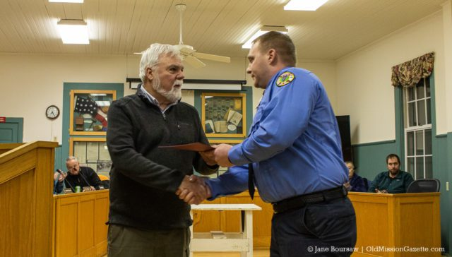 Peninsula Fire Department member Paul Lipke receives a Life-Saving Award for his actions during an industrial accident on Bluff Road on July 16, 2019; also pictured, Peninsula Township Supervisor Rob Manigold | Jane Boursaw Photo