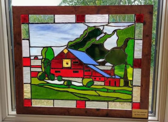 Darcy Schlitt's stained glass artwork of Roger and Martha Myer's barn at Peninsula Community Library | Jane Boursaw Photo