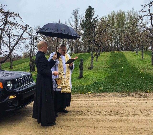 Father Rexroat from St. Joseph Catholic Church blesses the Holman Farm with holy water on the Old Mission Peninsula | Georgia Holman Photo