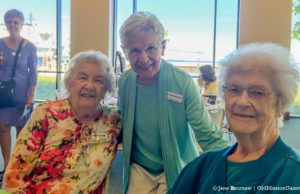 Carlene Hilt, Vi Solomonson and Mary Johnson (Ginny Dohm Coulter in the background) at a September 2016 Old Mission Women's Club meeting | Jane Boursaw Photo