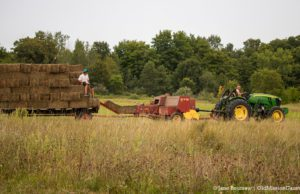 Jeremiah Warren and kids baling hay on the Old Mission Peninsula | Jane Boursaw Photo