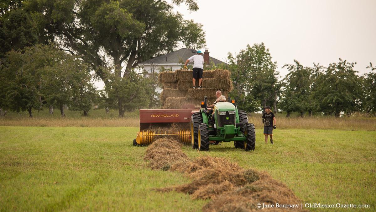 Jeremiah Warren and kids baling hay on the Old Mission Peninsula | Jane Boursaw Photo