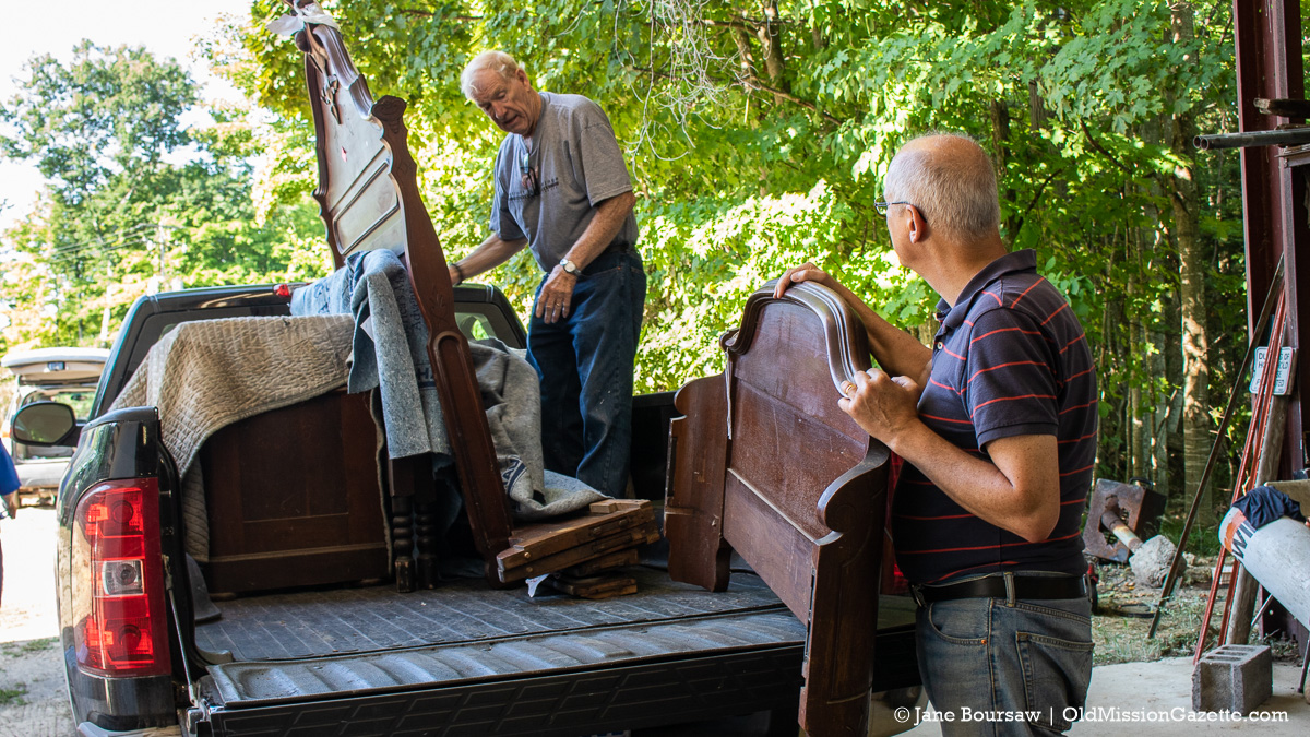 Bill Cole and Chris Rieser move Dougherty House furniture at the Big Jon warehouse on Peninsula Drive | Jane Boursaw Photo