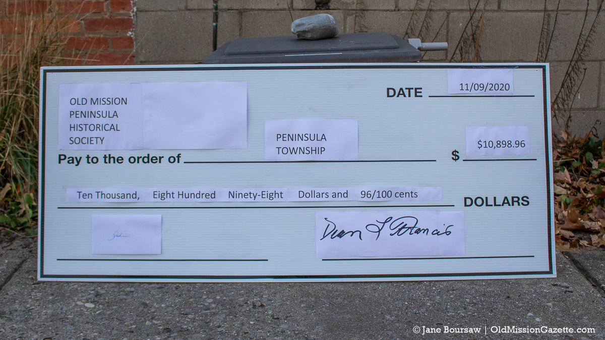 Check received from the Old Mission Peninsula Historical Society for Mission Point Lighthouse shutters | Jane Boursaw Photo