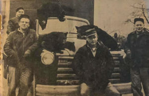 Old Mission Peninsula Bear Hunters, Circa 1955; left to right, Keith Warren, Bernard Kroupa, George Kelly and Ray Carroll | Old Mission Gazette Photo via Traverse City Record Eagle, Nov. 22, 1955