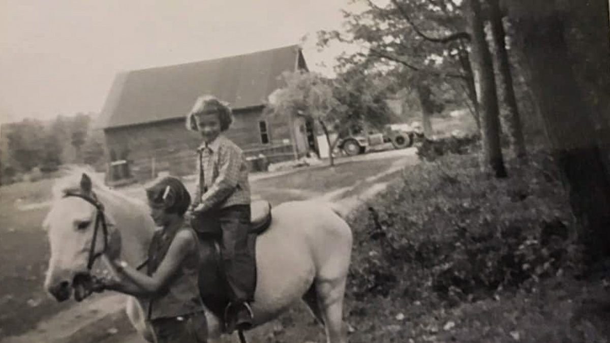 Linda Andrus (standing) with Jerilynn Cooper (riding Topper) in Old Mission, Michigan, 1959 | Jerilynn Cooper Marshall Photo