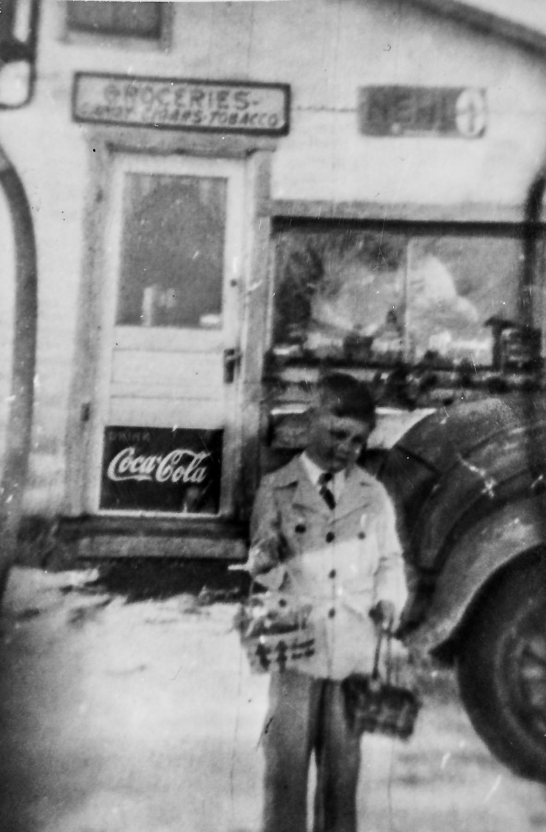 Bob Winnie at Winnie's Service, a gas station on the corner of Center Road and Old Mission Road on the Old Mission Peninsula, circa 1930s and 1940s   Photo courtesy of Mel Winnie
