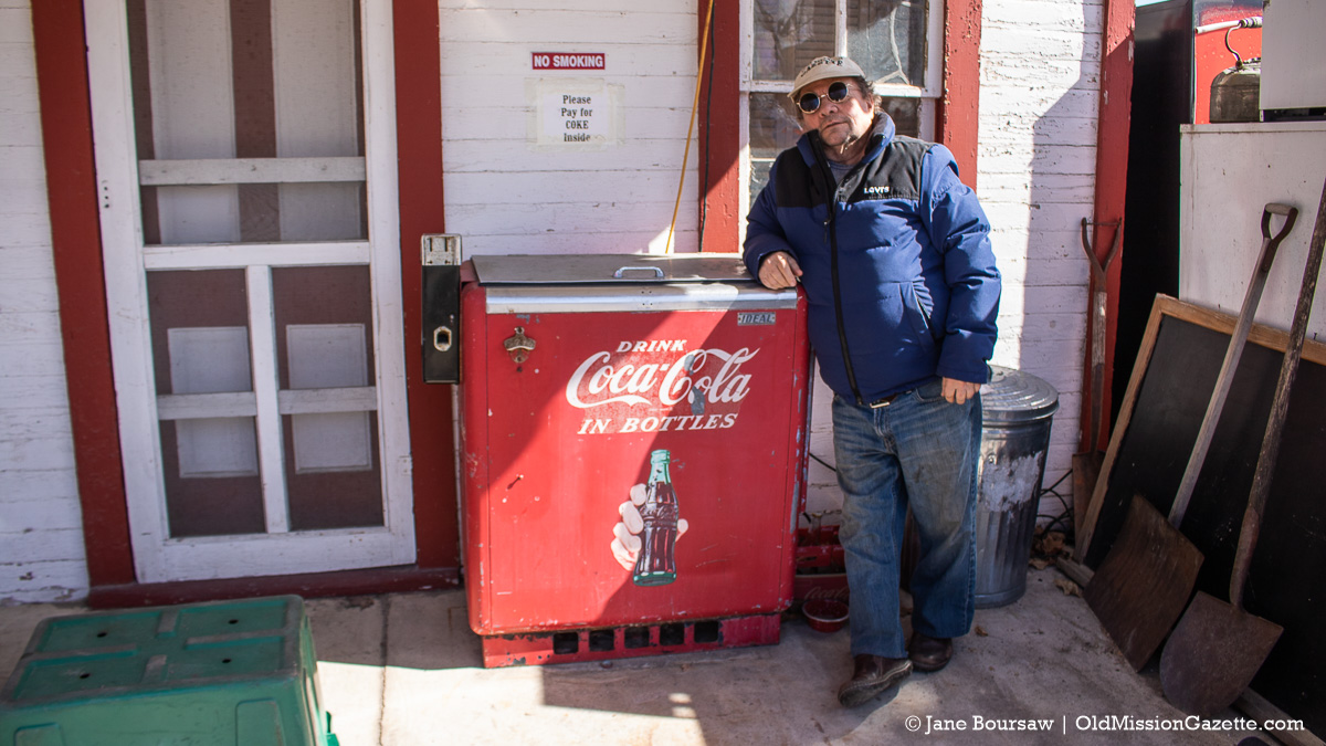 Tim Boursaw with the Coca-Cola machine at the Old Mission General Store, 65 years later | Jane Boursaw Photo