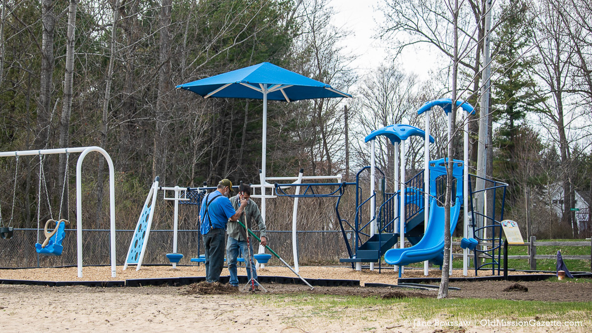 Parks Maintenance Bob Wilkinson and helper work on landscaping at the Haserot Beach play structure   Jane Boursaw Photo