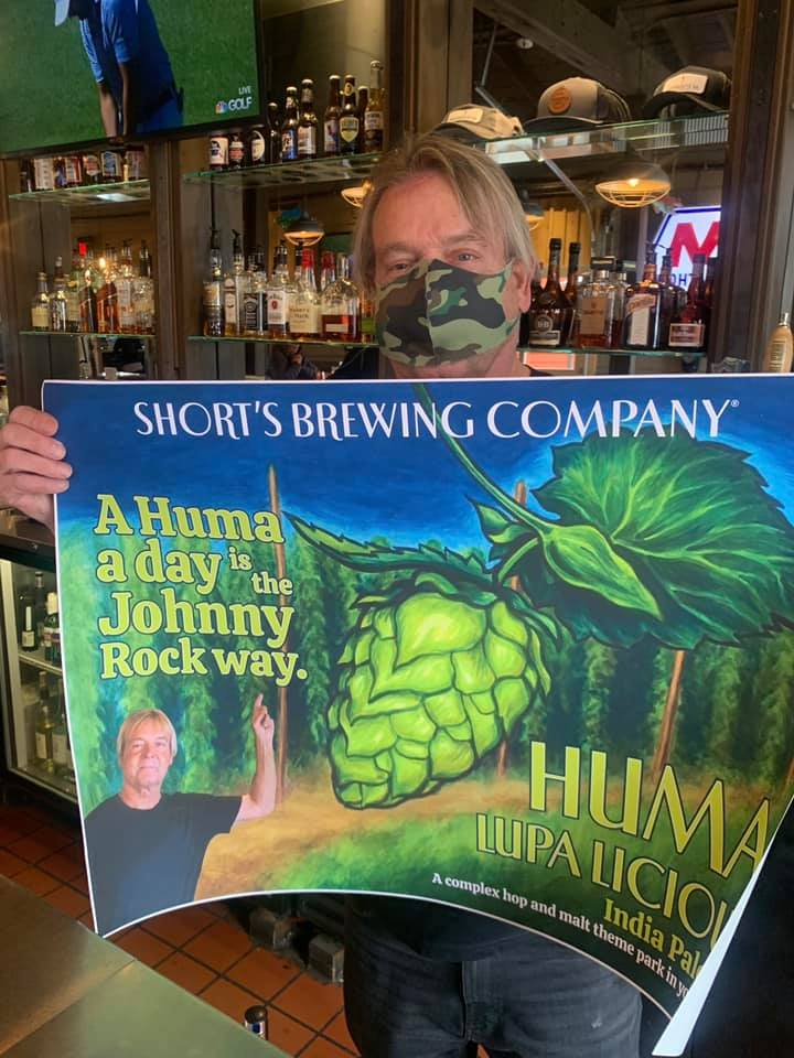 John Rokos gets his face on a Short's Brewing poster | Peninsula Grill Photo