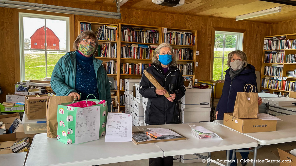 left to right, Michele Westcott, Pat Wittcopp and Madelyn Ryan of the Friends of Peninsula Community Library group, organizing the auction fundraiser for the library | Jane Boursaw Photo