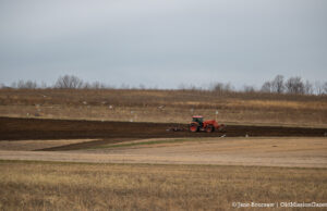 Tractor tilling the soil near Brinkman Road for bees and butterflies | Jane Boursaw Photo