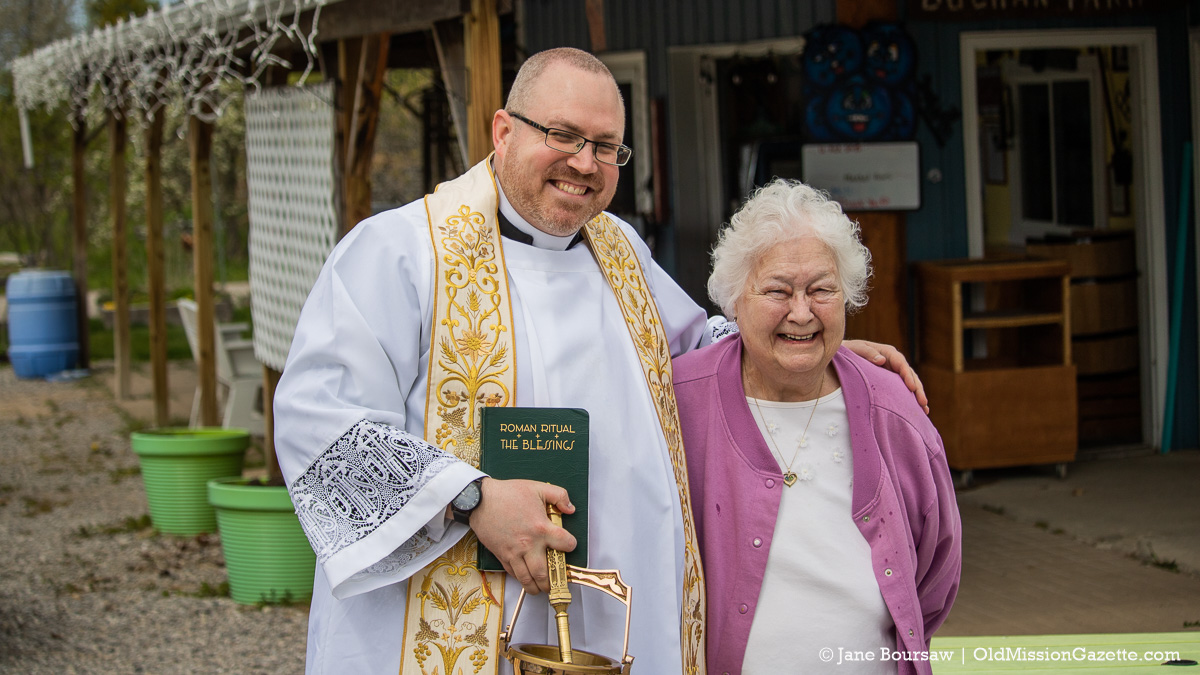 Father Rexroat with Karen Buchan at Buchan's Blueberry Hill; Blessing of the Blossoms on the Old Mission Peninsula | Jane Boursaw Photo