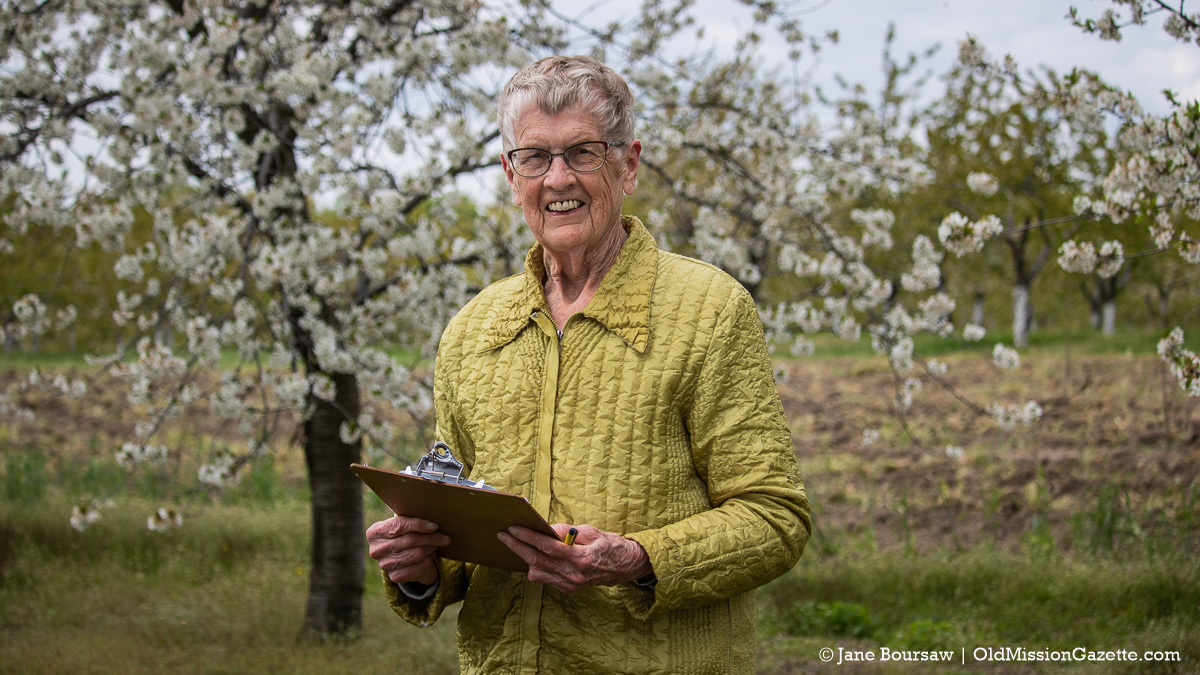 Mary Lyon in her orchard for Blessing of the Blossoms on the Old Mission Peninsula | Jane Boursaw Photo